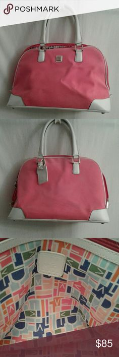 "DVF pink weekender/carryon This is an authentic DVF duffle bag in EUC. The exterior is hot pink microsuede with white leather accents. The interior is her logo geometrically repeated in bright colors.  It has one zippered interior pocket, silvertone metal feet, and a hot pink double zipper. It measures 20x13x8"" and opens to 21"". The twin handles have an 8"" drop. There is a matching luggage tag. Note: there are some 1/4"" travel marks see (pics 7&8). Diane Von Furstenberg Bags Travel Bags"