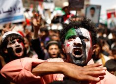 Protesters shout slogans during a demonstration calling for Yemen's former President Ali Abdullah Saleh to be put on trial in Sanaa