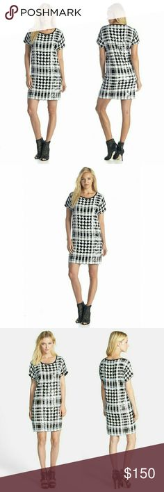 New! Michael Kors Houndstooth Sequin Party Dress For a radiant take on a trend-right motif, glistening sequins shape the houndstooth plaid of a figure-skimming shift dress by MICHAEL Michael Kors. Let the standout pattern shine by pairing it with solid black heels for a night out.  Color: Black and White  * Fabricated in a lightweight rayon.  * Rounded neckline. * Short sleeves.  * Straight hemline. * Slip-on design.  100% rayon.  Hand wash cold, lay flat to dry.  Measurements: Length: 36…