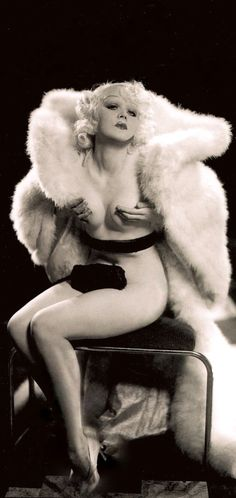"""MARION MARTIN dubbed """"Hollywood's blonde menace,""""  was noticed by Florenz Ziegfeld Jr.  in an Earl Carroll revue & signed to replace Gypsy Rose Lee in his Follies of 1933 wearing little but """"a feather and some beads."""" In Sinners in Paradise (1938) she was pigeonholed as a stripper, chorus girl or gold-digger type. She played sexy foils to the Marx Brothers and appeared in mostly secondary features. Retiring in 1951 she found happiness & stability in marriage. (please follow minkshmink)"""