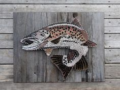 size : choose your size!  material : 3/4 thick birch wood - stained red oak. nails string  pattern : brown trout  shipping: USPS. fill out zipcode under shipping & policies to see shipping costs.  more info: 2-3 weeks production time.