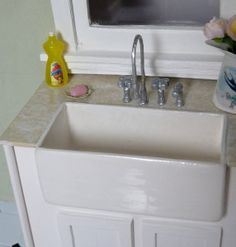 How to make a sink and faucet. In Spanish, good photo's.