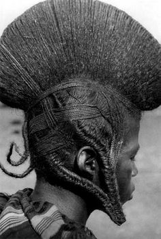 Fulani hairstyle,  Burkina Faso.  The Fulani are known to have the most elaborate, and most beautiful of Afrikan hair styles.  It would be difficult to find any more elaborate anywhere in the world.  (information courtesy of CIW)