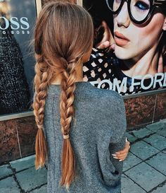 Two simple 3 strand braids. Cute hairstyle and super easy, probably a great hair do for going to the gym.