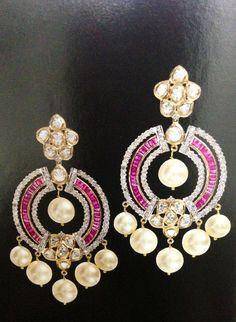 Uncut diamond ruby earrings.