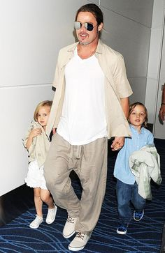 Look how big they are! Brad Pitt hung on to twins Knox and Vivienne in Japan