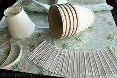 The V Spot: Upcycling boring lampshades with fabric, spray paint and a glue gun. She took the pleated part off