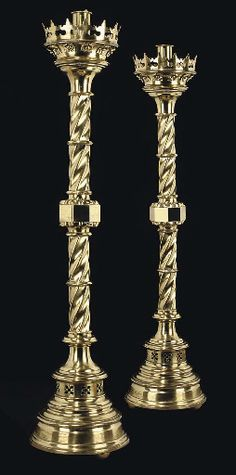 A PAIR OF VICTORIAN BRASS FLOOR-STANDING CANDLESTICKS  CIRCA 1860  With writhen stems and spreading bases.