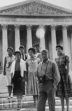 Daisy Bates and the Little Rock Nine In 1958, LIFE's Paul Schutzer photographed activist Daisy Bates (fourth from left) as she posed in front of the U.S. Supreme Court with members of the Little Rock Nine. Standing tall and proud in front of the highest court in the land, these civil rights pioneers assert their identities as Americans worthy of all every protection under the law. http://www.life.com/gallery/67141/life-at-75-civil-rights-photos?iid=yaml