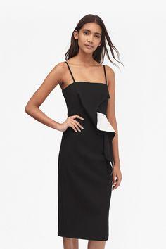 <ul> <li> Jersey fitted slip dress with monochrome ruffle front feature</li> <li> Thin, cami straps</li> <li> Below-knee length</li> <li> Hem split at back</li> <li> Back zip fastening</li> <li> UK size 10 length is</li> </ul>