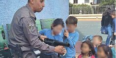 Israelare teaching young school children how to use weapons and suppress protestors, allowing the Israeli police force into schools to t...