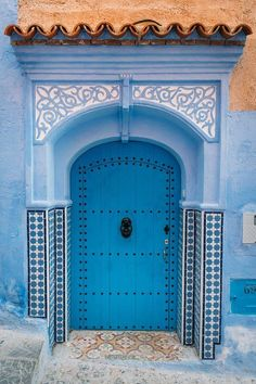 This is Chefchaouen, the blue city of Morocco. Its houses and shops are painted different shades of blue. Moroccan Doors, Moroccan Blue, Cool Doors, Unique Doors, Morocco Travel, Africa Travel, Blue City Morocco, Image Bleu, Doors Galore