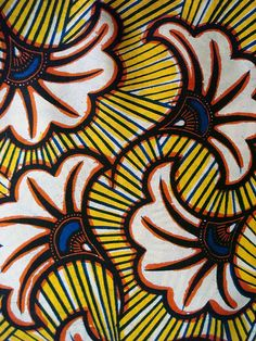 African wax print fabrics- I could do a brush embroidery pattern on the cake so it looks a little similar to this