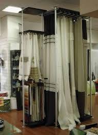 Risultati immagini per arredamenti negozio tendaggi