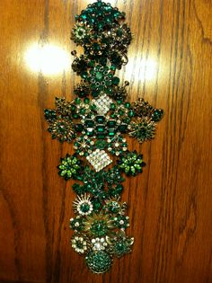 the planning of the vintage green rhinestone cross!