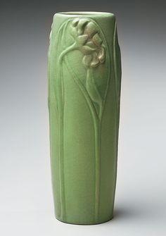 """Van Briggle Pottery (Artus Van Briggle). Vase with Apple Green Glaze and Floral Relief. White Earthenware. Colorado Springs, Colorado. Circa 1903. 11-1/2"""" x 4""""."""