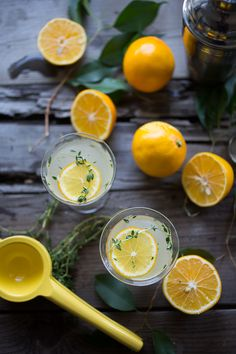 Meyer lemon gimlet...with thyme simple syrup...a refreshing cocktail you will love. | www.feastingathome.com