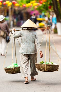 Street Vendor - Hoi An, Vietnam.  What a surprise……an amazingly beautiful town with small museums and a lot of history.
