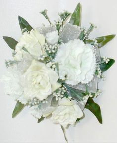 3 WHITE ROSES & MINI CARNATION CORSAGE - 3 white sweetheart roses, 2 white mini carnations and babies breath. Designed as a wrist corsage, but can be converted to a pin on corsage with included pins. Item #591.