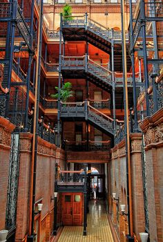 This is inside the Historic Bradbury Building in Downtown Los Angeles. This is the site of many commercials, TV shows and movies, but is mostly know for the 1982 cult classic Blade Runner.  This is very hard to shoot with the bright light from the skylights on top of the building. I shot bracketed my shots at iso200, at 10mm to produce this HDR image.   en.wikipedia.org/wiki/Bradbury_Building
