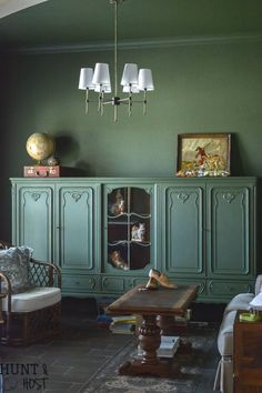Go big and bold with moody green in a home office, library or study. It's warm and inviting and a perfect color for a classic library look with rich wood tones. #salvagedliving #paintcolors #wallpaint #greenwallpaint