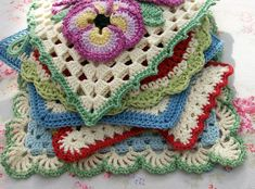 Knot Garden: Knitting and Crochet; great colors and ideas for floral squares