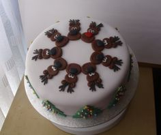 Reindeer Christmas - Gluten Free Chocolate Cake with chocolate buttercream and cherry conserve filling.  Covered in fondant.  Reindeers are fondant  Trees are fondant with silver and coloured candy balls.