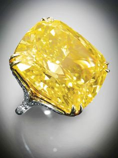 The Graff Vivid Yellow diamond ring. Sold for $16,347,847. Of exceptional beauty and extraordinary fire, this brilliant gem is one of the largest fancy vivid yellow diamonds in the world. It is listed in Ian Balfour's book Famous Diamonds.