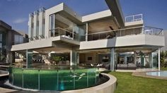 Luxury house with stone walls and almost entirely made of glass
