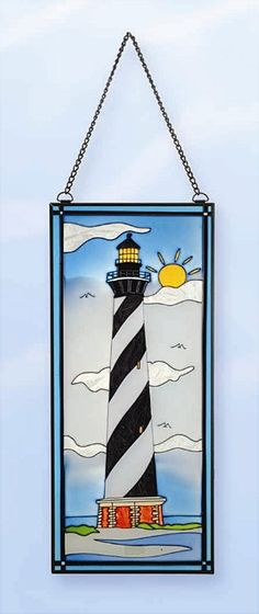 """Bright sunny lighthouse day at the beach scene. Size: 17.5"""""""" x 7.5"""""""" Actual weight 2 lbs. Photos don't do these stainglass lighthouses justice. Very crisp glass colors. They are nicer in actual appear"""