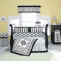 Black and White Nursery with soft yellow walls