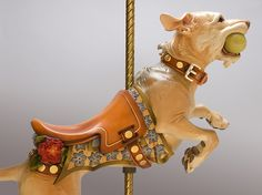 This guy makes wonderful life-sized dog carvings that are carousel or rockers.