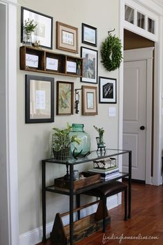 gallery wall - I love the wreath on the hook!