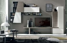 Two wall unit depths and the addition of metal Raster units add visual movement on the wall. Tv Unit Decor, Tv Wall Decor, Living Room Storage, Living Room Tv, Japanese Interior, Contemporary Interior, Lcd Wall Design, Furniture Design, New Homes