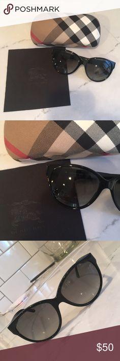 Burberry Sunglasses, Case and Lens Cloth One pair of black Burberry semi Cat-Eye sunglasses, it's own Burberry case, and it's lens cloth. Burberry Accessories Sunglasses