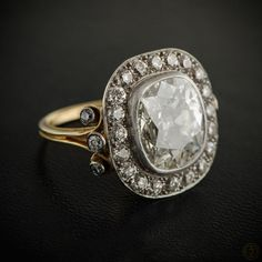 WOW! An Epic Vintage Cushion Cut Diamond Engagement Ring with a halo of diamonds! The setting is platinum on gold.