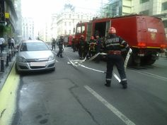 Firemen fighting with car fire in the streets of downtown Bucharest. Firemen, Bucharest, Colours, Firefighters, Fire Fighters, Fire Department