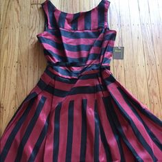 NWT! Red & black fit & flare dress NWT! Beautiful red and black fit & flare knee length sleeveless dress with belt. Falls above knee, back zipper closure. 100% polyester. Hand washable. Melonie T Dresses
