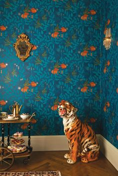 Nautilus Wallpaper This charming design stars a pair of enigmatic anglerfish shimmering in a dreamlike landscape of underwater plants and tendrils, in green and orange