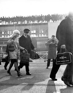 John and Cynthia boarding the plane to New York at London Airport on 7th February 1964, one of the first times John and Cyn were seen together publicly.