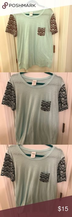 Cute VS PINK light blue and tribal print t shirt L Large Victoria's Secret pink t shirt light blue with black and white tribal print sleeves and pocket very lightly worn no great condition and super cute! PINK Victoria's Secret Tops Tees - Short Sleeve