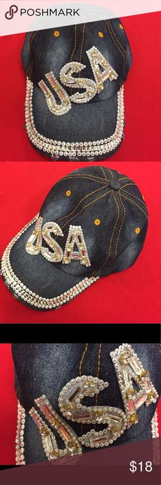 """Gold and denim Bling baseball cap Show your USA pride in this trendy and stylish Crystal Rhinestone """"USA"""" Embellished Baseball Cap. Made from  100 % cotton, this hat is breathable and will keep you cool and comfortable on hot summer days. This cap is adorned with the statement """"USA"""" in crystal rhinestone letters across the crown and more crystals on brim for a glamorous yet sporty look. An adjustable closure.One size fits most. Note the little tears are part of the design of the worn denim…"""
