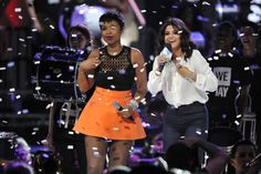 """Selena Gomez with Jennifer Hudson on stage while co-hosting """"We Day Illinois"""" at the Allstate Arena in Rosemont, Illinois. April 30, 2015."""