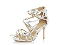 This glitzy metallic strappy sandal is the ultimate in girly glamour. It comes with a high stiletto heel, cross over straps and zip fastening. Style it with a little black dress for the perfect party look.