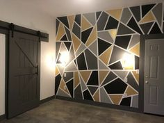 This was for our master bedroom in the guest house, I have seen images floating around and really wanted to do it!I chose 4 different colors - light grey, dark… Installing Wainscoting, Geometric Wall Paint, Closet Door Makeover, Patchwork Tiles, Bedroom Wall Designs, Baskets On Wall, Paint Designs, Diy Wall, Diy Home Decor