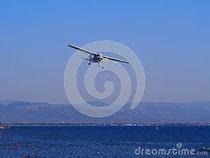 Cessna plane in flight over the sea