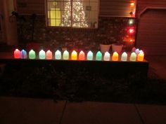 Milk jugs half full of water with colored Christmas lights inserted in the tops. Clever!