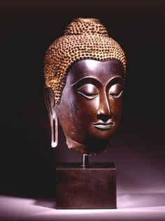 Bronze Head of Buddha Thailand; Sukhothai style, post-classic period, Kamphaeng Phet 15th c. bronze H. 37 CMS, 14 ½ INS