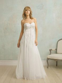 Fabric: Tulle  Embellishment : Embroidery  Silhouette: Empire Waist  Straps: Strapless  Neckline:Sweetheart  Sleeves: Sleeveless  Back: Zipper up  Train : Chapel Train  PHOTOGRAPHED IN:Ivory    Estimated Delivery Time: 30-40 days.  $295.00