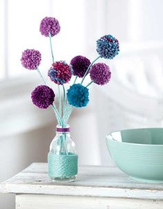 Plush, colorful yarn is the perfect accent for creative crafting! Wrap it around bottles or hoops, weave it through a web of spokes, bundle it into plump pom-poms - you can even tie it into your hair